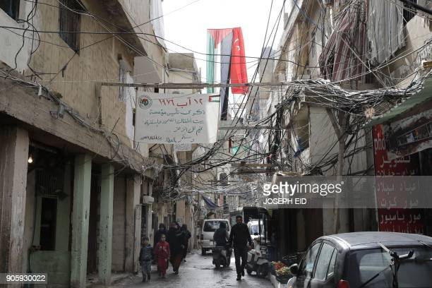 Palestinians are seen walking in the Burj alBarajneh camp in the Lebanese capital Beirut on January 17 2018 The UN agency for Palestinian refugees...