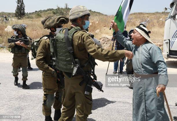 Palestinians argue with Israeli soldiers during a protest to mark the 53rd anniversary of Naksa or setback day, near the Jabara military check point...