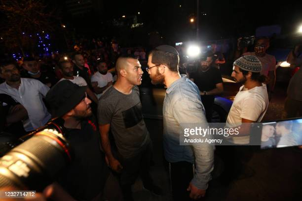 Palestinians argue with Jews during a demonstration at Sheikh Jarrah neighborhood after Israeli government's plan to force some Palestinian families...