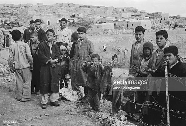 Palestinians at the Kalandia refugee camp on the West Bank 11th February 1956 Original Publication Picture Post 8270 The People Who Wait For War pub...