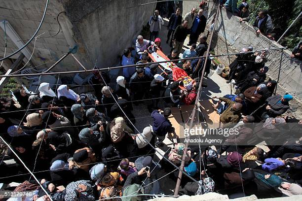 Palestinians attend a funeral ceremony held for Iyad Secdiye who was shot dead by Israeli soldiers during clashes between Palestinians and Israeli...