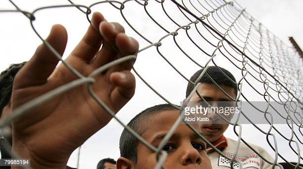 Palestinians attend a human chain protest starting at the southern Rafah border with Egypt and running to the Erez checkpoint at the northern border...
