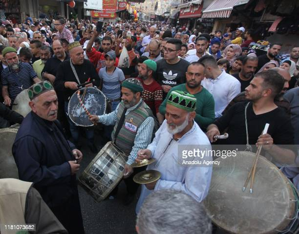 Palestinians attend a parade within celebrations marking Mawlid alNabi in Nablus West Bank on November 09 2019