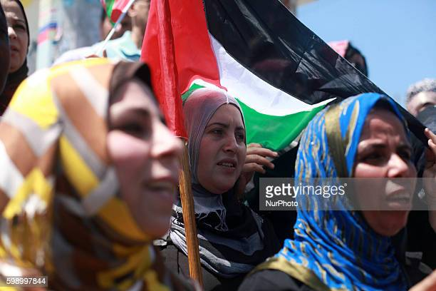 Palestinians attend a protest in Gaza City calling for an end to Palestinian divisions on April 22 2014 Members of the rival Fatah movement of...