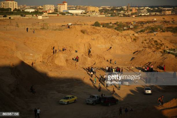 Palestinians attend a rally against the demolition of the Tel EsSakan hill south of Gaza City on October 13 2017 Palestinian and French...