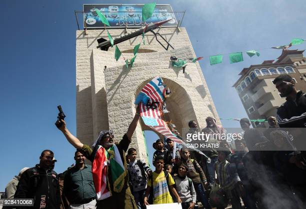 TOPSHOT Palestinians attend a rally in support of women held in Israeli jails on March 7 2018 in Rafah in the southern in Gaza Strip head of...
