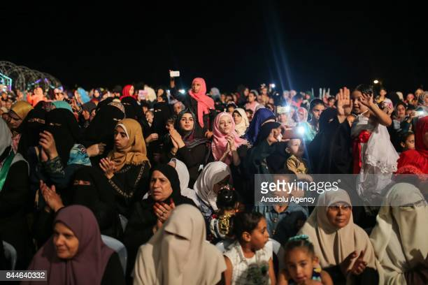 Palestinians attend a wedding ceremony of 200 couples organised by Hamas in Gaza City Gaza on September 08 2017 Palestinians Muslims condemned the...