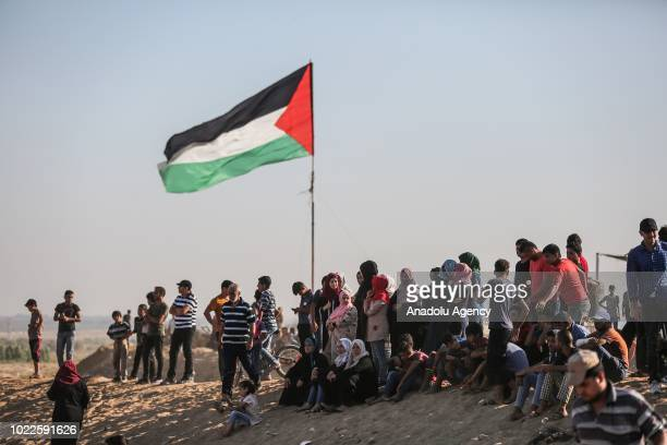 "Palestinians attend the 22nd Friday of ""Great March of Return"" demonstration near Israel-Gaza border, in Khan Yunis, Gaza on August 24, 2018."