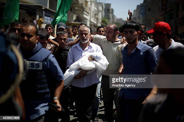 Palestinians attend the funeral ceremony of Hamas's military commander Mohammed Deif's son seven-month-old Ali Deif and wife 27-year-old Widad Deif...