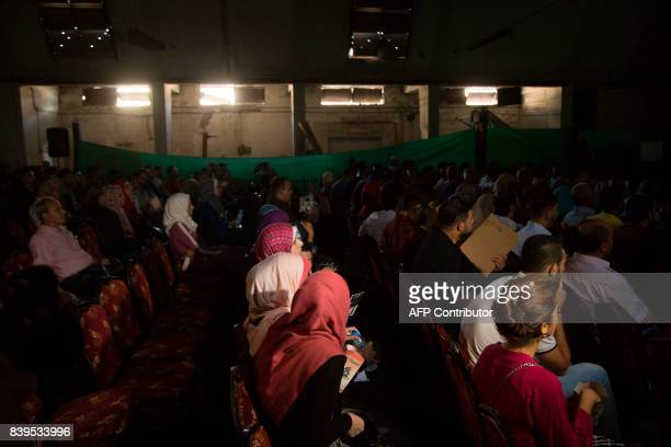 Palestinians attend the screening of '10 Years' at Samer Cinema in Gaza City on August 26 2017 The Samer Cinema in Gaza City the oldest in the strip...