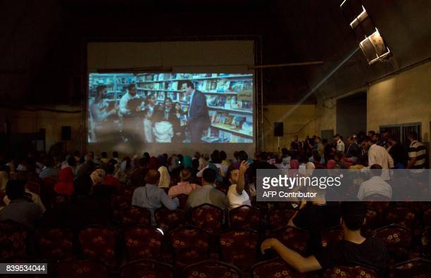 Palestinians attend the screening of 10 Years at Samer Cinema in Gaza City on August 26 2017 The Samer Cinema in Gaza City the oldest in the strip...
