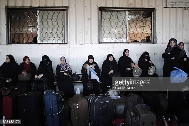 TOPSHOT Palestinians await permission to enter Egypt as they gather at the Rafah border crossing in the southern Gaza Strip on on November 14 2016...