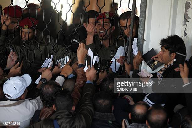Palestinians await permission to enter Egypt as they gather inside the Rafah border crossing between Egypt and southern Gaza Strip on December 21,...