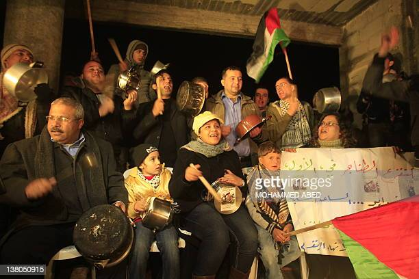 Palestinians beat pots and pans in Gaza City on February 1 2012 to demand the end the Palestinian division and implementation of the reconciliation...
