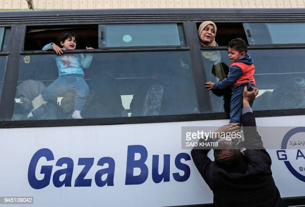 Palestinians bid farewell as they prepare to travel into Egypt after the Rafah border crossing was opened for three days for humanitarian cases, in...