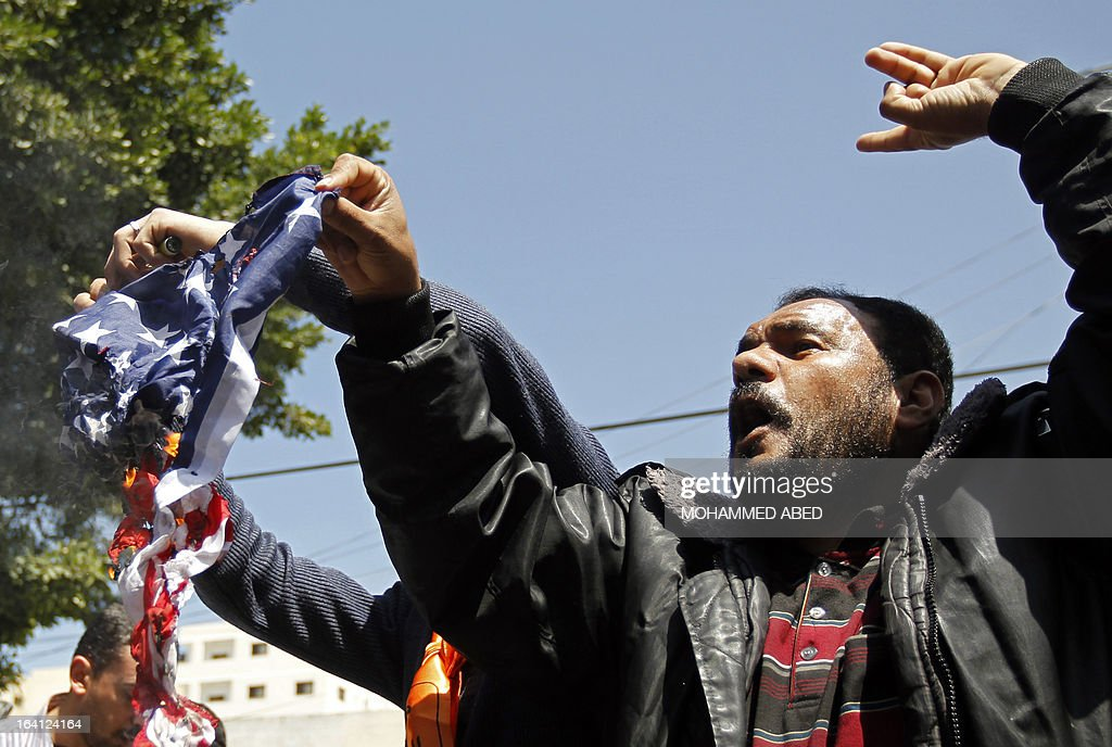 Palestinians burn an American flag during a protest in Gaza City against US President Barack Obama's visit on March 20, 2013. Obama is visiting Israel and the Palestinian Territories for the first time as US president, on a mission to ease past tensions with his hosts but facing scepticism about his plans to thwart Iran's nuclear threat.