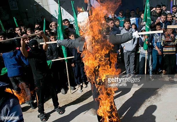 Palestinians burn an effigy depicting Israeli Prime Minister Benjamin Netanyahu during a rally organized by the Islamist Hamas movement at the Rafah...
