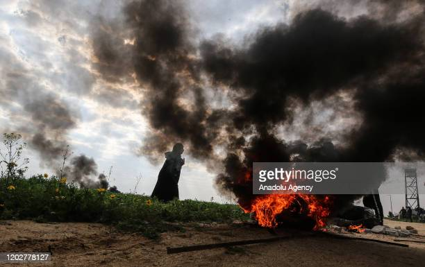 Palestinians burn tires during a protest after a Palestinian was killed and three others injured by Israeli gunfire near border of the Gaza Strip, in...