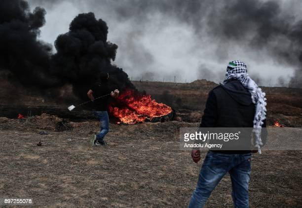 Palestinians burn tires during a protest against US President Donald Trump's announcement to recognize Jerusalem as the capital of Israel and plans...