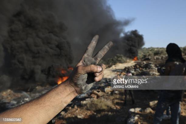 Palestinians burn tires during demonstrations against the expansion of the Jewish settlement outpost of Eviatar, on the lands of Beita village, near...