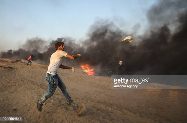 "Palestinians burn tires during the ""Great March of Return"" demonstration near Israel-Gaza border, in Khan Yunis, Gaza on September 28, 2018."