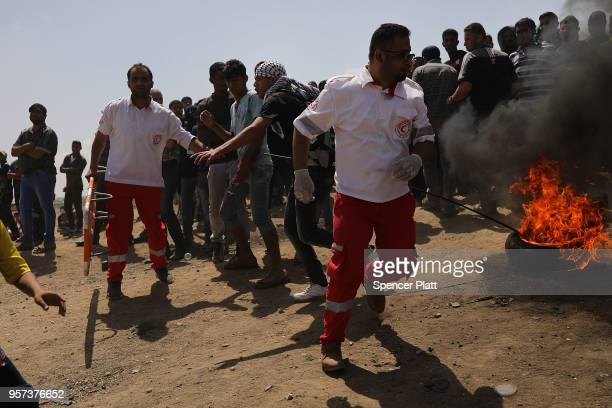 Palestinians burn tires near the border fence with Israel as mass demonstrations at the fence continue on May 11 2018 in Gaza City Gaza One man was...