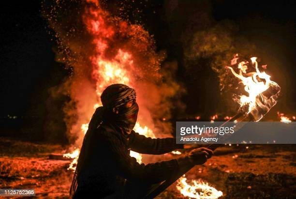 Palestinians burn torches and tires during the 'Great March of Return' demonstration in Shuja'iyya neighborhood of Gaza City Gaza on February 18 2019