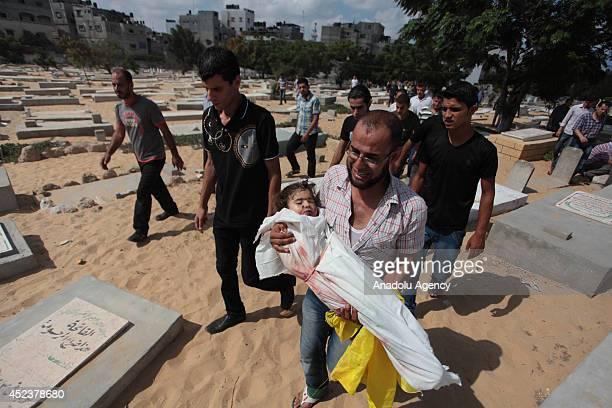 Palestinians carry the bodies of Palestinian Abu Jarad family's eight members named Naim Musa Abu Jarad Abd Musa Abu Jarad Siham Musa Abu Jarad Recaa...