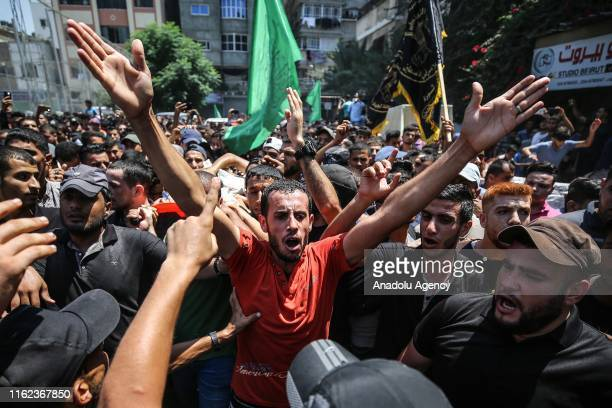 Palestinians carry the body of 24yearold Palestinian Mahmoud alWalayda who was killed by Israeli army fire near Gaza Strip during his funeral...