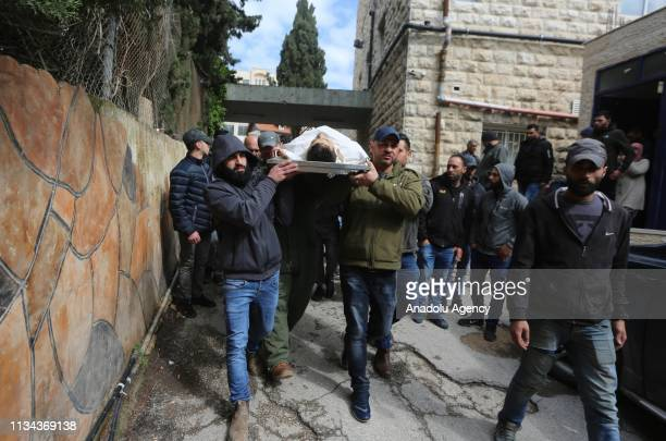 Palestinians carry the body of Ali Edwan who was killed by Israeli forces near occupied West Bank city of Ramallah West Bank on April 2 2019 Ali...