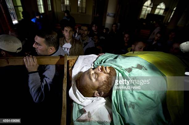 Palestinians carry the body of Fadel Mohammed Halawa who was shot dead by Israeli forces near the border in northern Gaza during his funeral in Gaza...