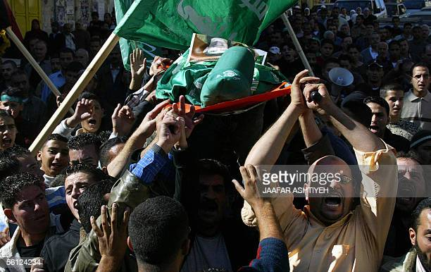 Palestinians carry the body of fifteenyearold Mohammed Abu Salha 20 November 2005 who was killed yesterday as he and at least two other teenagers...