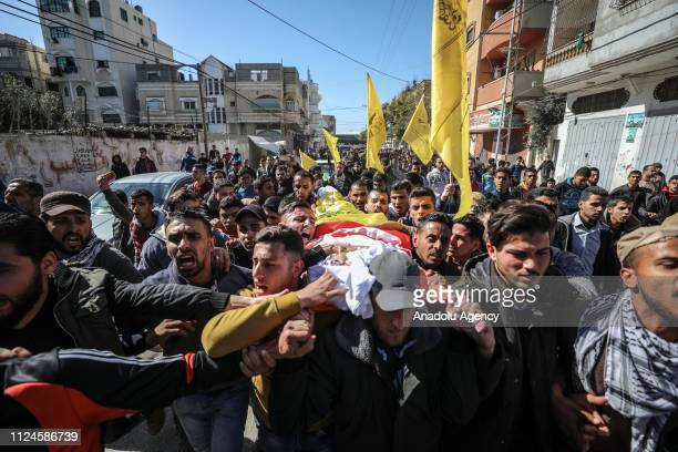 Palestinians carry the body of Hassan Nabil Nofal who was hit in the head by an Israeli teargas bomb last Friday in the Bureij refugee camp and died...