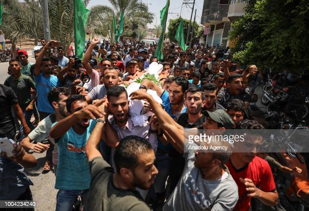 Palestinians carry the body of Kerem Arafat killed by Israeli occupation forces during funeral ceremony in Khan Yunis Gaza on July 23 2018 Kremem...