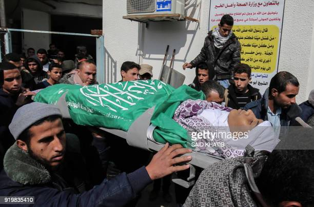 Palestinians carry the body of seventeenyearold Abdullah Abu Sheikha who was killed following Israeli air strikes during his funeral in Rafah in the...