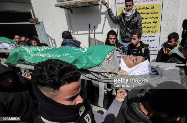 Palestinians carry the body of seventeenyearold Salam Sabah who was killed following Israeli air strikes during his funeral in Rafah in the southern...