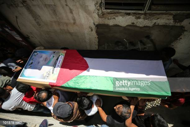 Palestinians carry the coffin of a 23 year old pregnant woman and her 18monthold baby who were killed by Israeli airstrikes during a funeral ceremony...