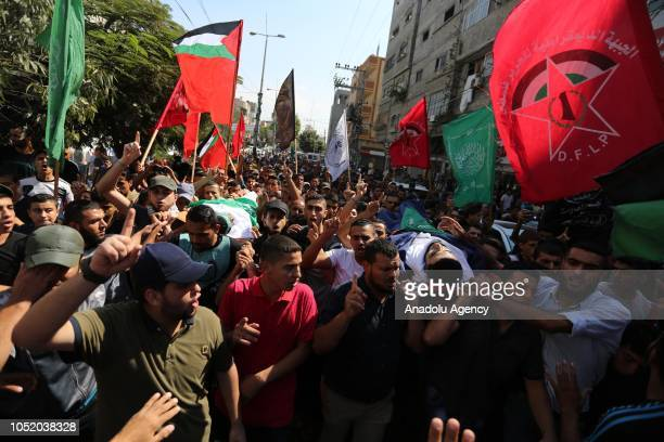Palestinians carry the dead bodies of Ahmed Ibrahim Zaki alTaweel and Ahmad Ahmad Abu Naim who were killed after Israeli soldiers intervened in...