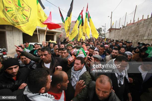 Palestinians carry the dead body of 16yearold Ali Amr Qino who was killed in clashes with the Israeli army that erupted in the village of IraqBurin...