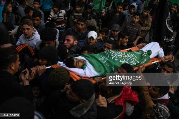 Palestinians carry the dead body of 16yearold Amir Abu Mosaed who was killed after being shot in the chest in clashes with the Israeli army that...