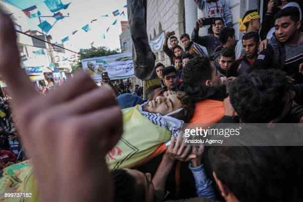 Palestinians carry the dead body of 20yearold Cemal Mohamed Maslah who was wounded on the clashes between Palestinian protesters and Israeli security...