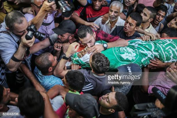 Palestinians carry the dead body of Abdurrahman Ebu Humeyse who was killed by Israeli security forces during a demonstration against Israeli...