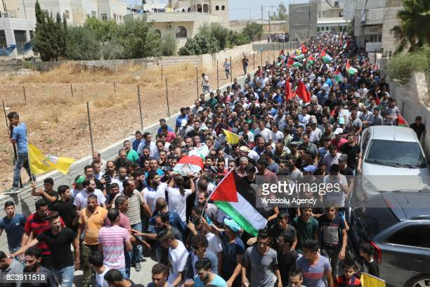 Palestinians carry the dead body of Muhammad Fathi Kanaan who was killed by Israeli security forces during a demonstration against Israeli...