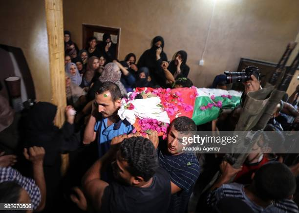 Palestinians carry the dead body of Osama Khalil Abu Khater who was killed by Israeli soldiers during Great March of Return demonstrations near...