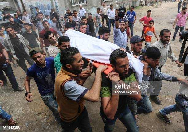 Palestinians carry the dead body of Palestinian Shawqi Abu Asr who was martyred by Israeli soldiers during the Great March of Return demonstrations...