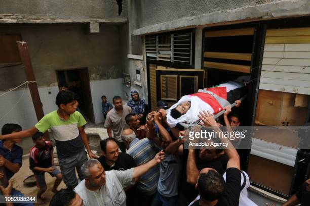 Palestinians carry the dead body of Tamer Abu Armana who was killed after Israeli soldiers intervened in 'Great March of Return' demonstrations...