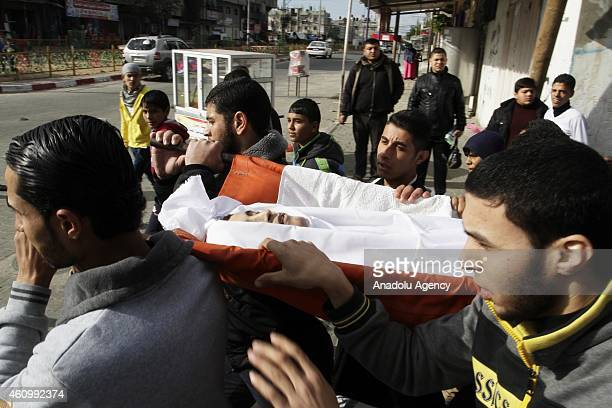 Palestinians carry the dead body of Zaki AlHoobi shot dead by the Egyptian soldiers as he was turning back to the Rafah side after deciding not to...