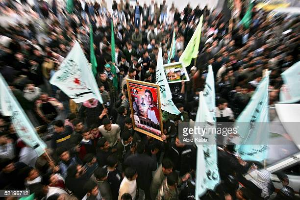 Palestinians celebarte as 15 palestinian bodies arrive at the Palestinian parlement park after being returned by Israel on February 14 2005 in Gaza...