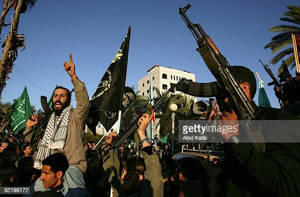 Palestinians celebrate as 15 palestinian bodies arrive at the Palestinian parlement park after being returned by Israel on February 14 2005 in Gaza...