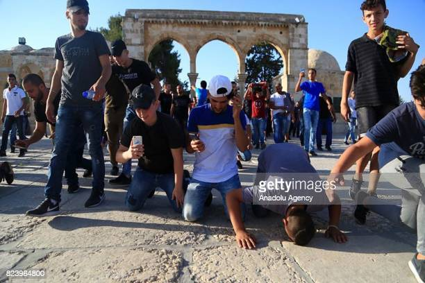 Palestinians celebrate as they enter the Al Aqsa Mosque following the removal of Israeli security measures at the entrances to Al Aqsa Mosque in...